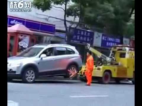 Chevy SUV Kicks Chinese Tow Truck's Arse