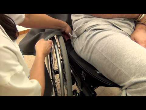 Positioning in chair with EasyGlide oval mini and footstool