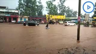 A boda boda rider submerged by floods at Kagio townin Kirinyaga