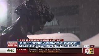 Downtown Cincinnati less busy than usual as snow falls