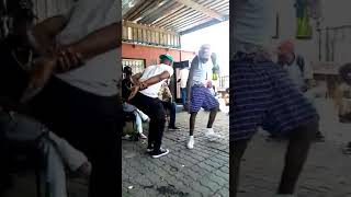 Manizo dancing with his crew