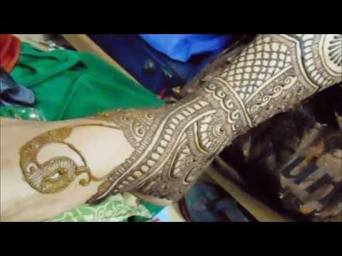 peacock mehndi design for feet bridal by mehndi artistica