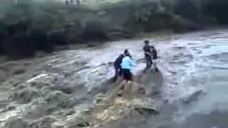 Family falls down waterfall