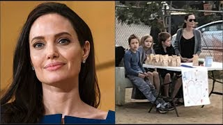 Анджелина Джоли с детьми продает еду в парке