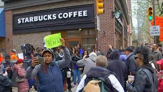 Protesters swarm Starbucks after two black men arrested