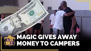 Magic Johnson Gives Away Money To Kids At Jordan Clarkson's Camp