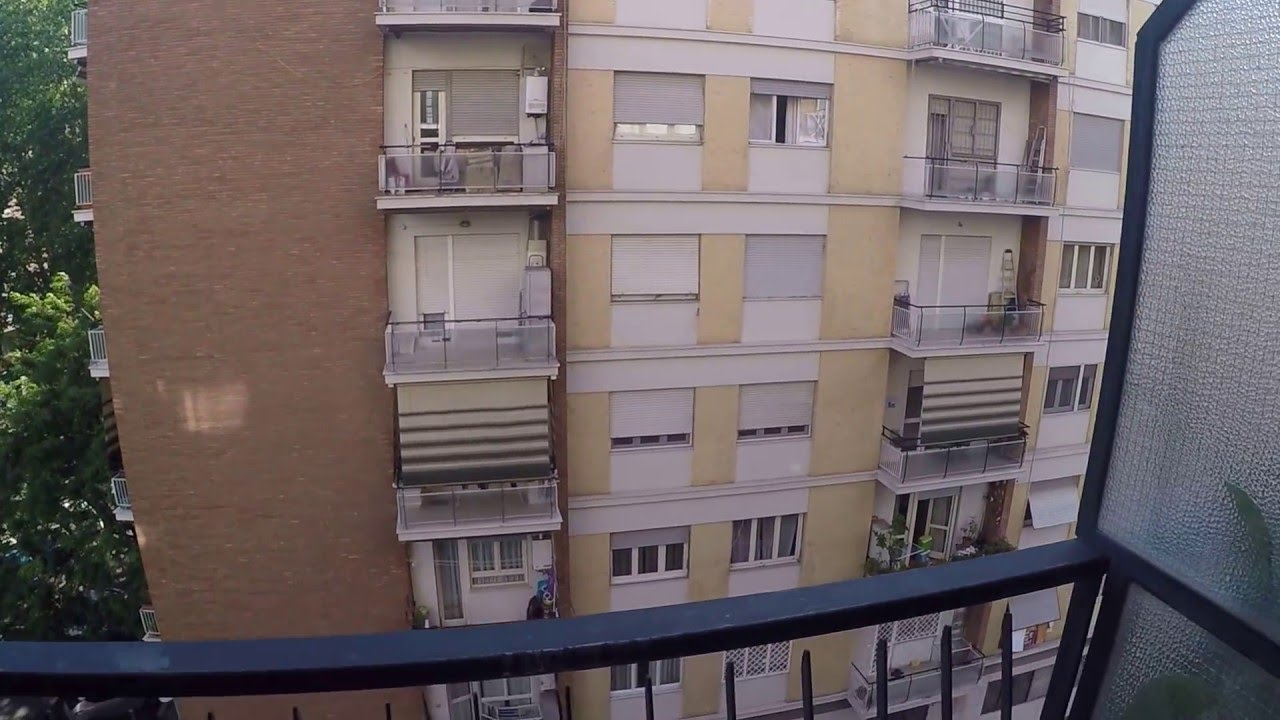 Rooms for rent in apartment with balconies and a dryer in Portuense area