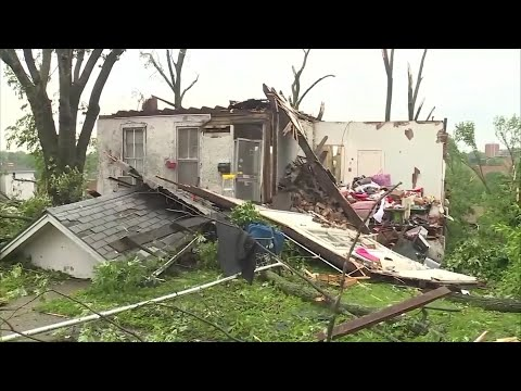 The large tornado that moved over Jefferson City, Mo., before midnight heavily damaged buildings, including the home of survivor Larry Jett who thought he would die in the storm. (May 23)