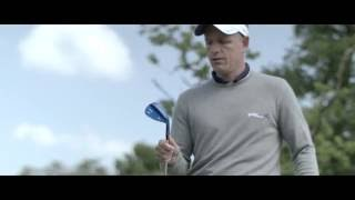Luke Donald tests the feel of his new Mizuno T7 Wedges