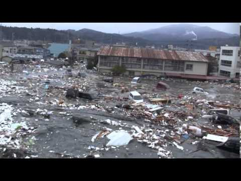The most remarkable tsunami footage I've ever seen. A canal drains, and the water slowly returns upstream. The flow becomes unreal, and it just keeps coming and coming.