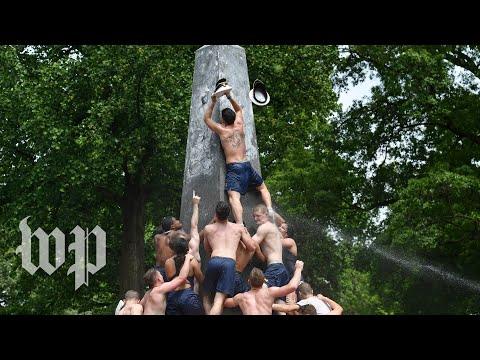 Hundreds of Naval Academy plebes climb monument