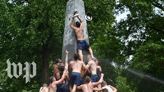 Hundreds of Naval Academy plebes climb monument