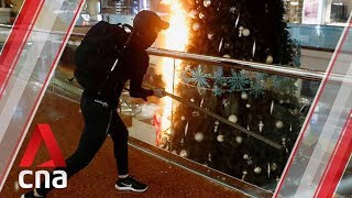 """Protesters in Hong Kong vandalised Festival Walk shopping centre in Kowloon Tong on Tuesday (Nov 12) evening and set fire to the Christmas tree in the mall.   Hong Kong is shutting all schools on Thursday after protesters stepped up their """"blossom everywhere"""" campaign of road blocks and vandalism across the city: https://cna.asia/34VxPbf  (Video: Reuters / Stand News)  #HKprotests  Subscribe to our channel here: https://cna.asia/youtubesub   Subscribe to our news service on Telegram: https://cna.asia/telegram  Follow us: CNA: https://cna.asia CNA Lifestyle: http://www.cnalifestyle.com  Facebook: https://www.facebook.com/channelnewsasia Instagram: https://www.instagram.com/channelnewsasia Twitter: https://www.twitter.com/channelnewsasia"""