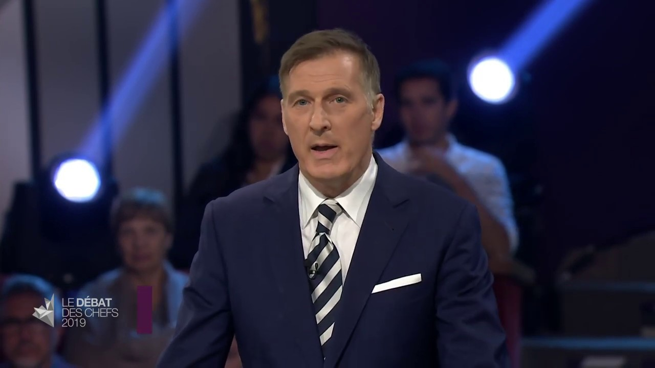 Maxime Bernier answers a question about fighting climate change