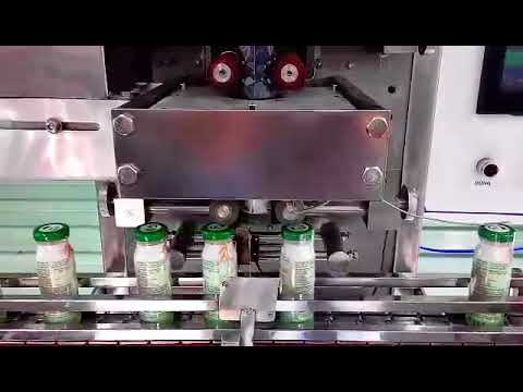 Máy phóng nhãn màng co