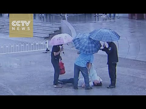 Chinese nurse goes viral after performing CPR in the rain