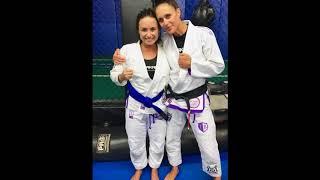 Demi Lovato receiving her blue belt in Brazilian Jiu-Jitsu