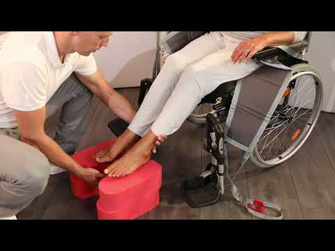 Application of the sling leg sections using a Footstool