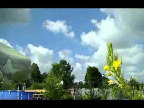 Strange Clouds Timelaps One Day Official Video by Kanope.flv