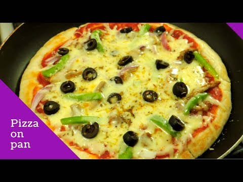 How To Make Pizza On Pan Or Tawa – How To Make Pizza Without Oven by (HUMA IN THE KITCHEN)