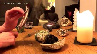 How to use a sage smudge stick to cleanse crystals