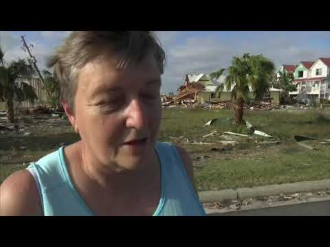 A woman searched for a missing friend who did not evacuate from Mexico Beach, Florida, while others surveyed the damage to their lives and belongings in the aftermath of Hurricane Michael. (Oct. 11)