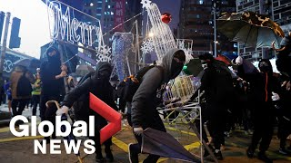 Hong Kong protesters block roads, clash with police on New Year's Eve