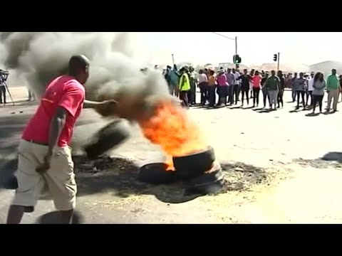 Soweto residents clash with police over land distribution