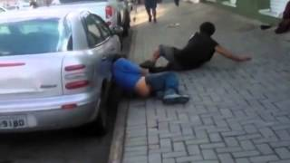 Drunk ninja kicks the air while fighting against another man - FAIL