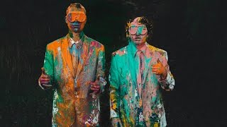 Paint War With White Tuxedos On