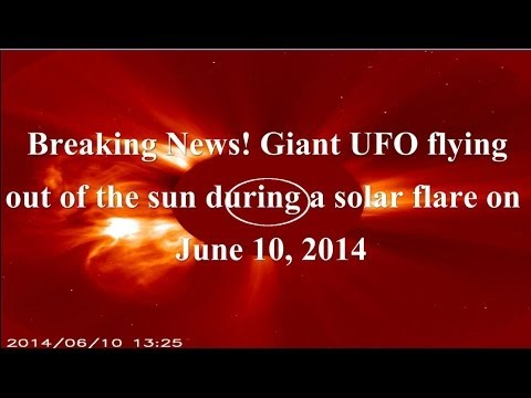 Breaking News! Giant UFO flying out of the sun during a solar flare on June  10, 2014