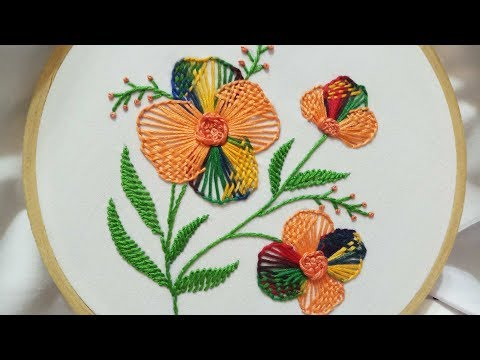 Hand embroidery of flower with buttonhole stitch and checkered stitch