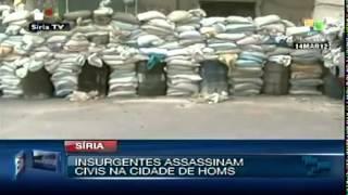 preview picture of video 'Insurgentes sírios assassinam civis na cidade de Homs'