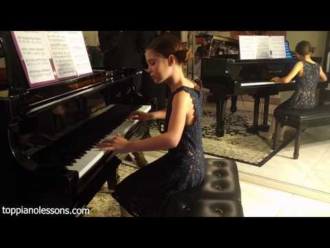 Fiona is practicing to play One Summer's Day. The concert  is on 6:57 for those who don't want to wait