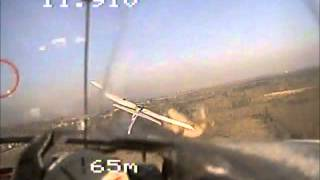 A rc-plane fires successfully at a second rc-plane with an airsoft-machine-gun