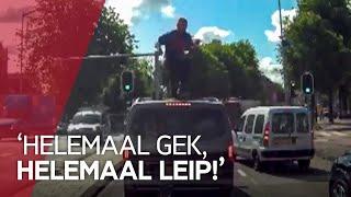 Man uit Litouwen beklimt en vernielt auto's bij Waterlooplein
