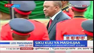 President Uhuru Kenyatta inspects the guard of honour at Uhuru park