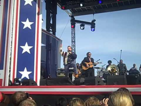 Stewart and Colbert singing