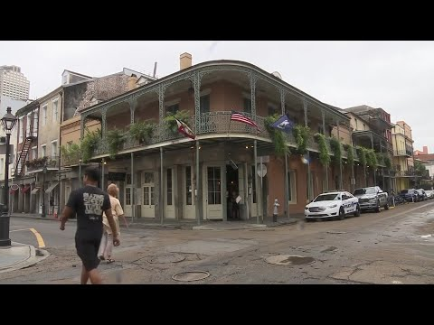 As Tropical Storm Barry's outer bands began to blow through New Orleans, residents and tourists alike didn't let it dampen their plans. (July 12)