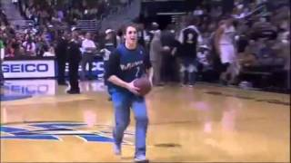 Fan makes a basketball dunk while he
