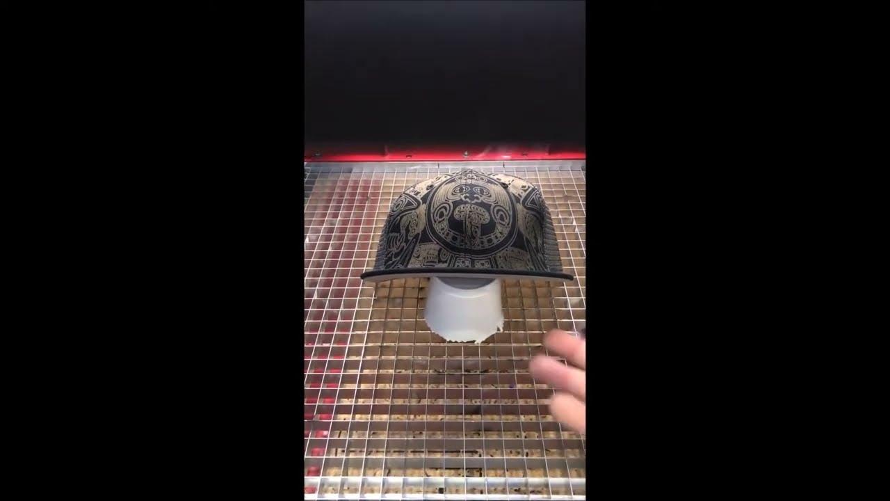 Z Galva Etching Aztec Hieroglyphs onto Baseball Cap