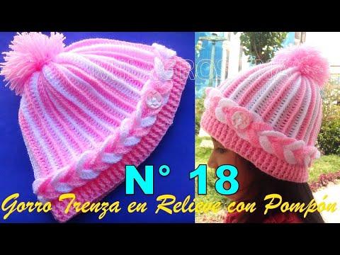 5db2213af Como hacer una Gorra a crochet para niñas en punto trenza en relieve con  pompón paso paso .