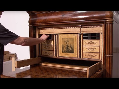 Demonstrating the Clever Secret Compartments in This Masterpiece Desk