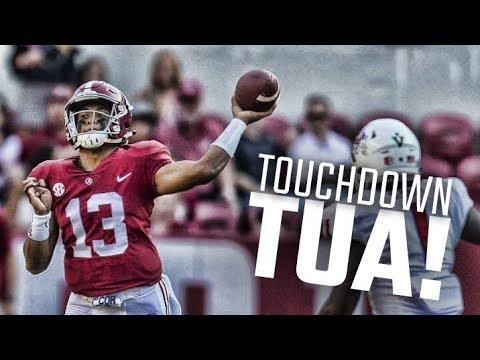Alabama's Tua Tagovailoa scores his first touchdown