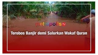 Terobos Banjir demi Salurkan Wakaf Quran