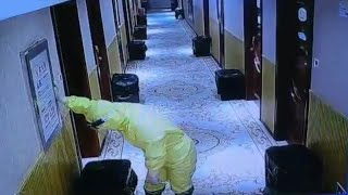 Video clip shows medical staff waddling down Hubei hospital corridor after long work shift