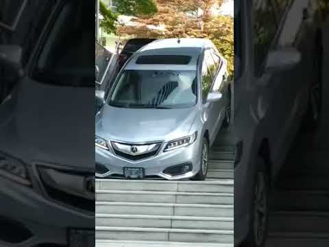 Complete moron drives her new Acura DOWN THE STAIRS