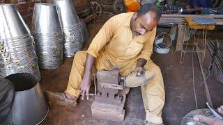Talented Craftsman Making Metal Bucket