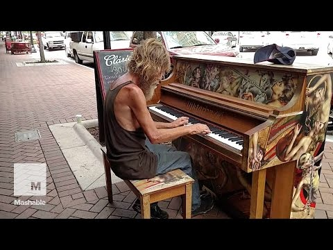 Homeless man plays Sail Away on street piano