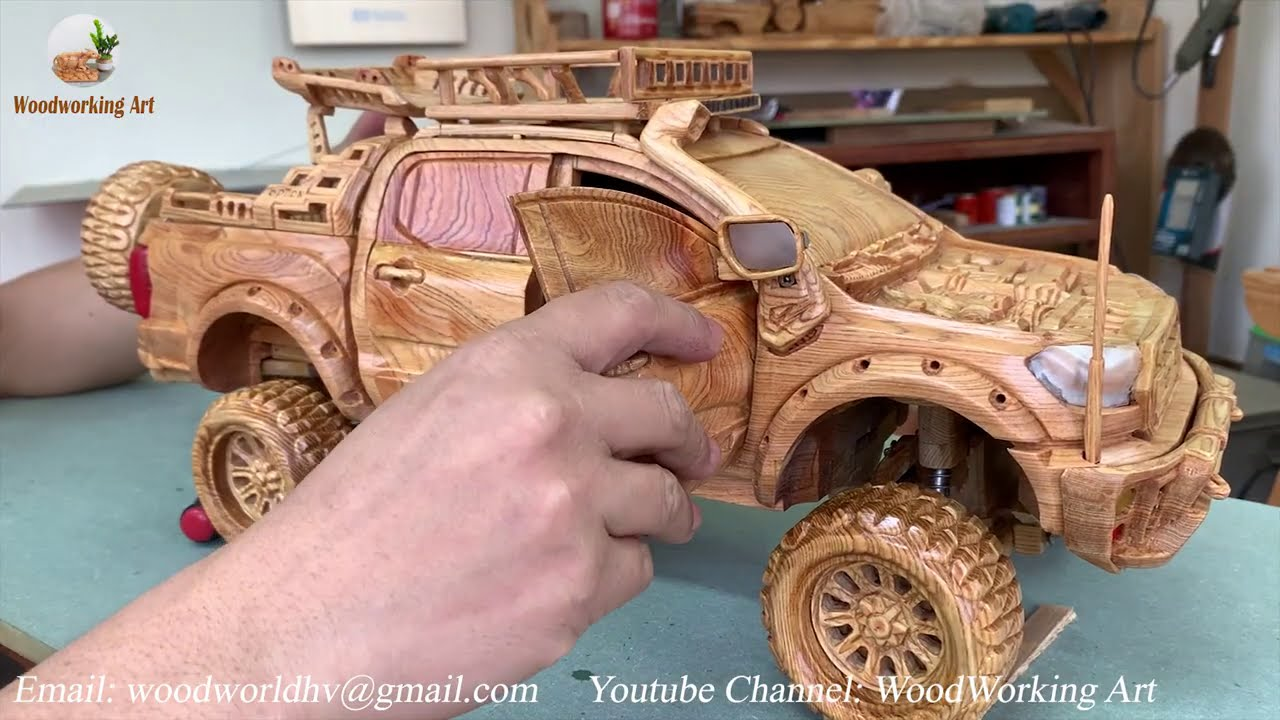wood carving artist making ford raptor by woodworking art